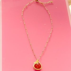 Gold tone station beads with red jasper pendant
